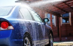 Blue-car-washing-on-open-air-14775710